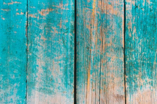 Vieille clôture bleue en bois