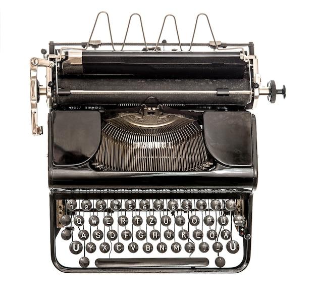 Vieille machine à écrire isolée sur fond blanc. objet ancien. vue de dessus