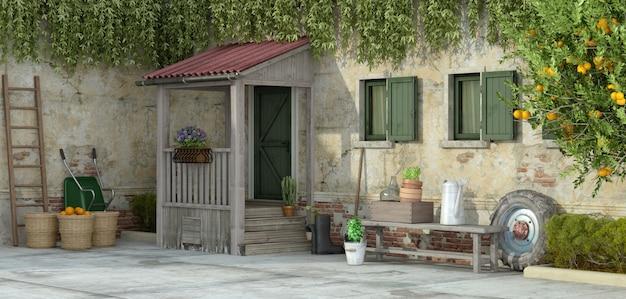 Vieille maison avec des outils de jardinage - rendu 3d