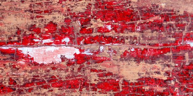 Vieille peinture en bois fond rouge texture clôture rustique planche de mur de maison