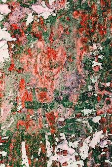 Vieille peinture craquelée sur le mur. texture grunge rouillée.