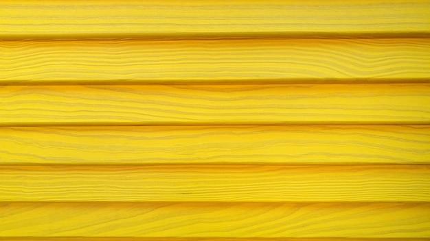 Vieille peinture de structure de clôture en bois dans la texture de fond de cadre de couleur jaune en bois jaune