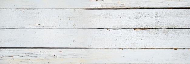 Vieille planche de bois peinte en blanc. fond de bannière