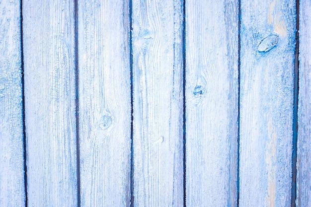 Vieille porte de planche de bois bleu grange drapé fond de texture
