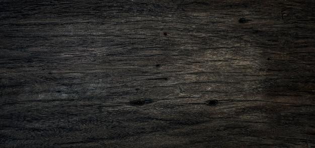 La vieille texture de planche de bois foncé peut être utilisée comme arrière-plan