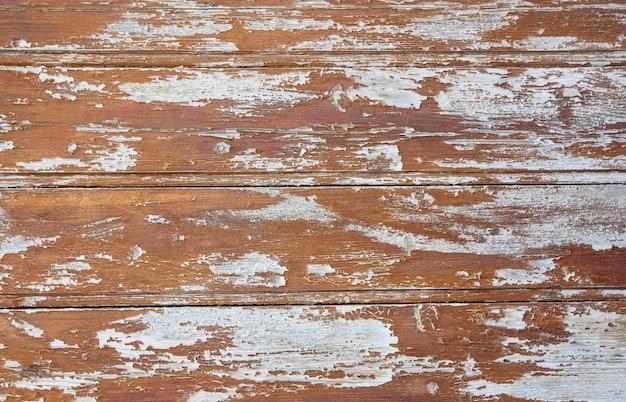 Les vieilles planches en bois peint de texture marron
