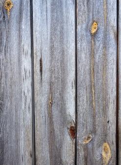 Vieilles planches grises et noueuses. contexte pour la conception.