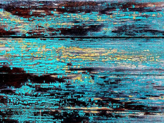 Les vieilles planches sont peintes de différentes couleurs, lumineuses et contrastées. fond de peinture jaune et vert bois foncé