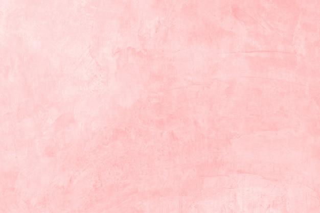 Vieux béton peinture plastique rose sur la texture de mur de ciment et de fond avec l'espace.
