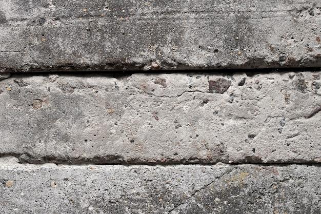 Vieux blocs de béton mur fond closeup