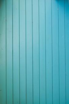 Vieux bois vintage couleur turquoise avec des planches verticales