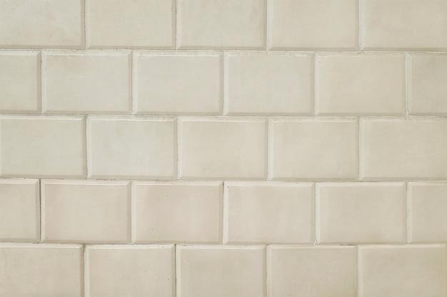 Vieux carrelage beige brique mur texture d'arrière-plan