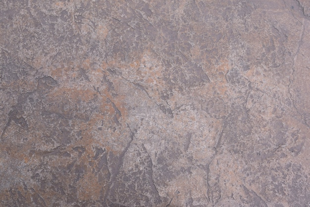 Vieux ciment muré fragment de mur de fissure, texture de sol en béton fissuré