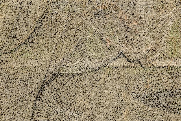Vieux filet de pêche gris silhouette curonian spit