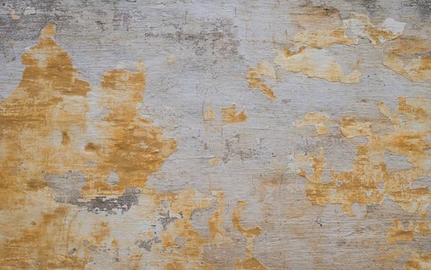 Vieux fond de béton jaune et gris texturé. vue de dessus et espace de copie