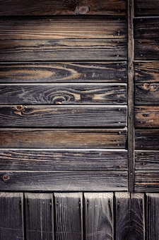 Vieux fond en bois sombre minable.
