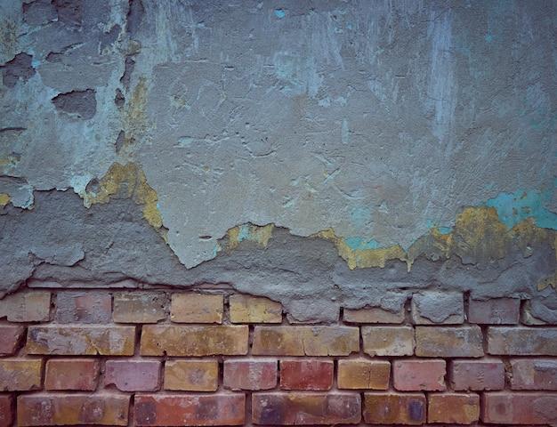 Vieux fond de brique avec du plâtre.