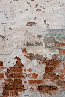 Vieux fond de brique rouge texturé, surface de l'ancienne texture cassée, vue de dessus, espace copie