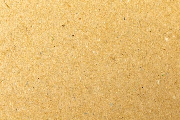 Vieux fond brun de texture de papier d'artisanat de recyclage, photo en gros plan de surface de carton