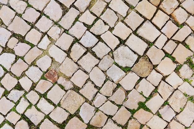 Vieux fond de chaussée de pierre beige