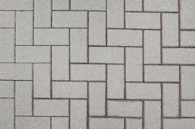 Vieux fond de chaussée de pierre grise