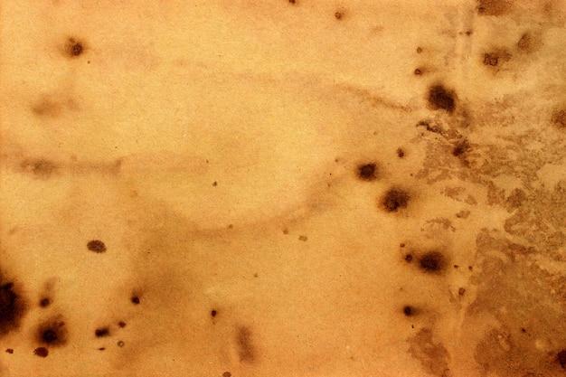 Vieux fond grunge de papier brun. texture de couleur café liquide abstraite.