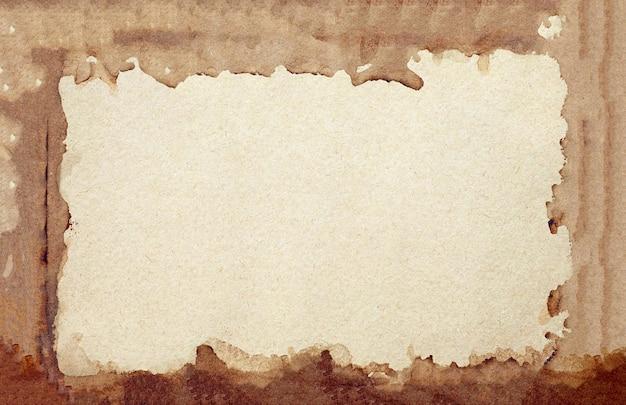 Vieux fond grunge de papier brun. texture de couleur café liquide cadre abstrait.