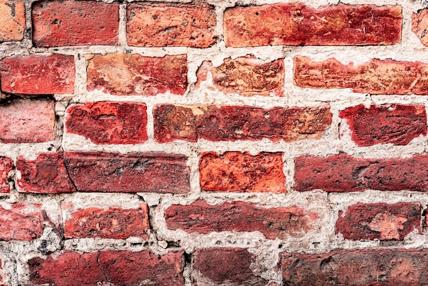 Vieux fond de mur de brique orange et blanc