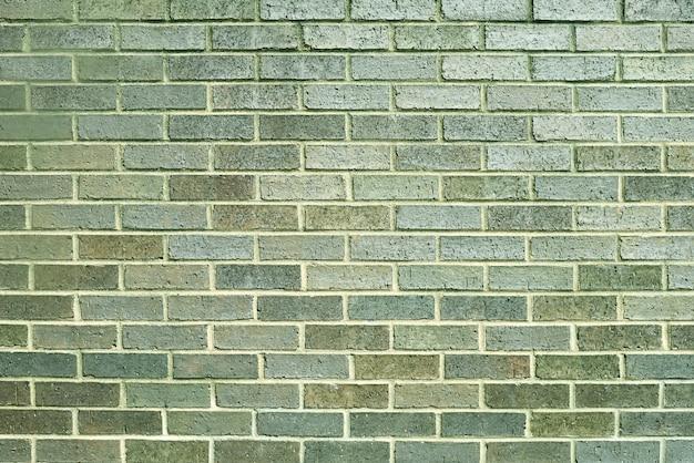 Vieux fond de mur de brique verte