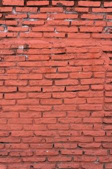 Vieux fond de mur de brique verticale