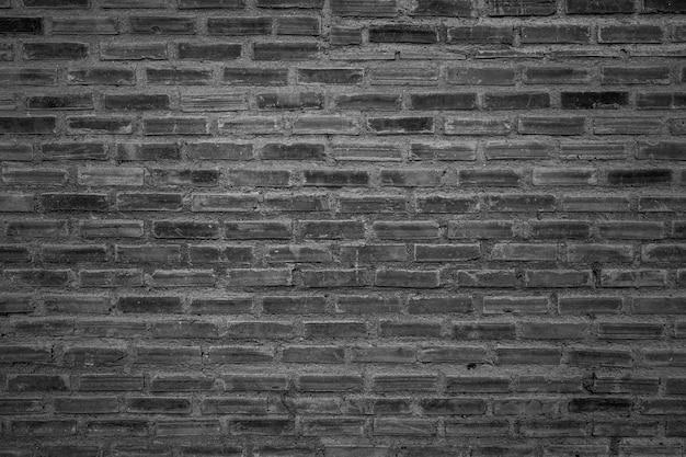 Vieux fond de mur de briques avec filtre noir et blanc