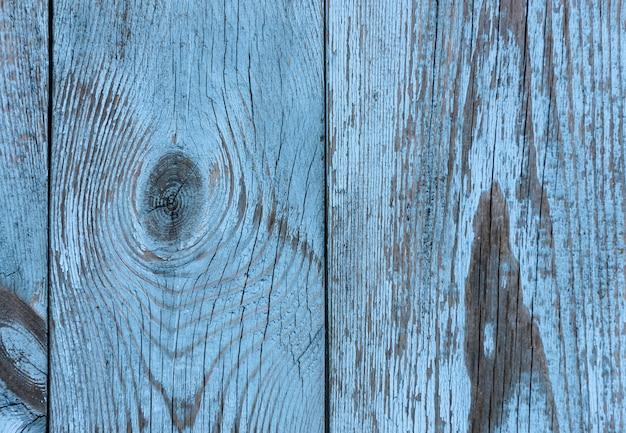 Vieux fond de mur texturé en bois peint bleu et gris vintage