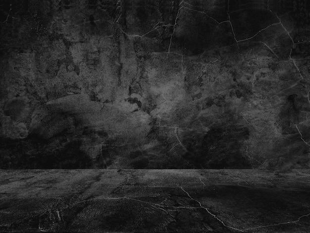 Vieux fond noir. texture grunge. fond d'écran sombre. béton de tableau noir