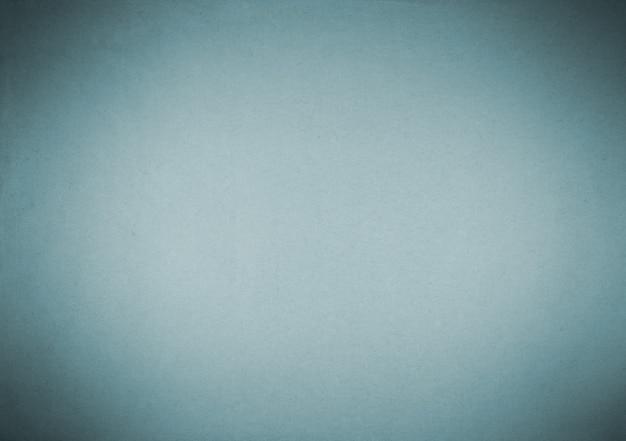 Vieux fond de papier bleu avec vignette sombre.