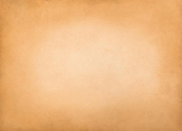 Vieux fond de papier brun avec vignette sombre.