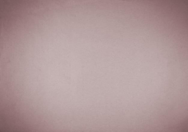 Vieux fond de papier rose avec vignette sombre.