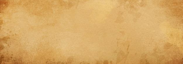 Vieux fond de parchemin en papier brun avec des taches vintage battues et des éclaboussures de couleur beige d'encre