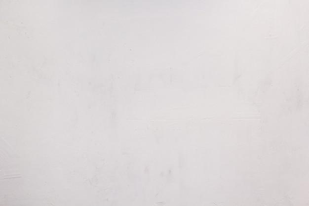 Vieux fond de surface peinte blanche, mastic de mur ou texture de table en bois
