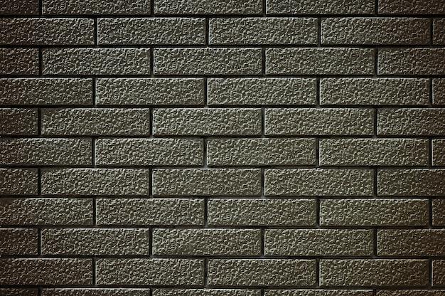 Vieux fond de texture de mur de brique noire marron.