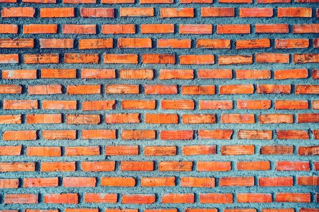 Vieux fond de texture de mur de brique rouge grunge