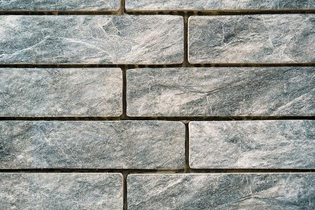 Vieux fond de texture de mur de briques grises vintage.