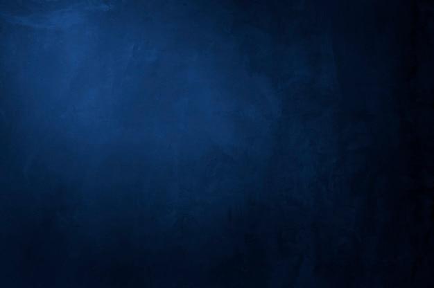 Vieux fond de texture de mur de ciment bleu foncé vide