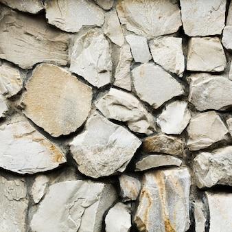 Vieux fond de texture de mur en pierre gros rochers