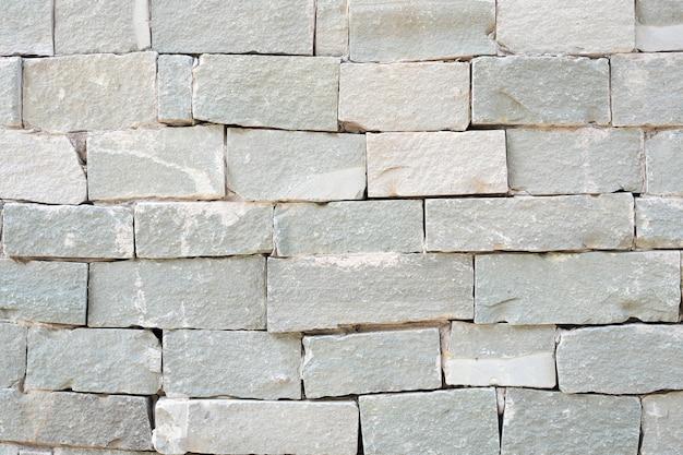 Vieux fond de texture de mur en pierre de sable gris. sol