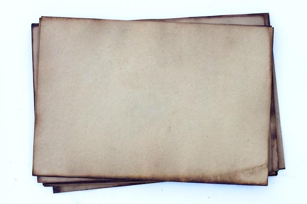 Vieux fond de texture de papier brun foncé.
