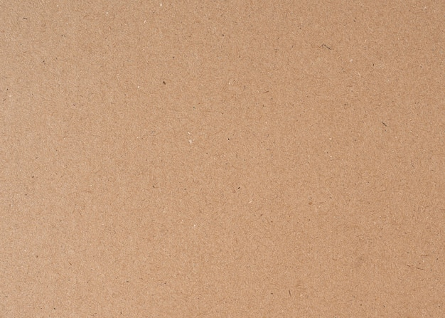 Vieux fond de texture de papier carton recyclé brun close up