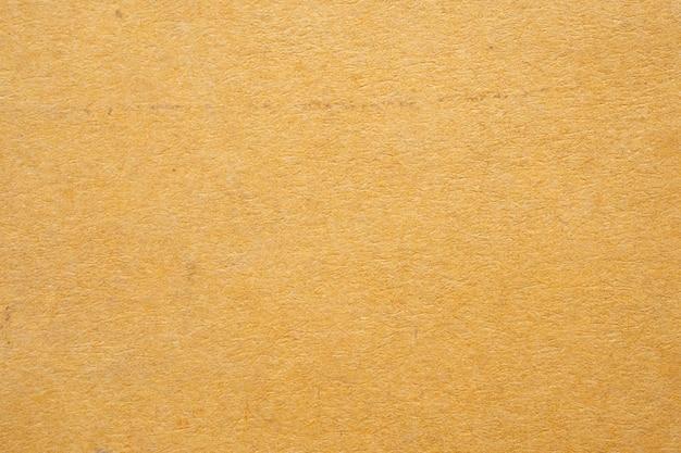 Vieux fond de texture de papier carton recyclé brun