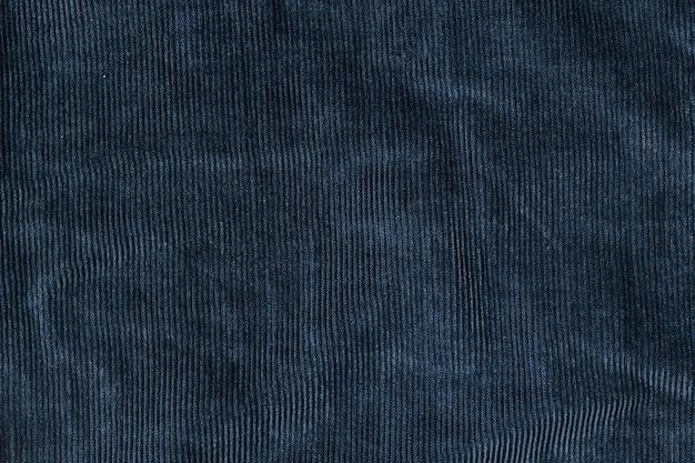 Vieux fond de texture de velours côtelé bleu. concept de texture de tissu en velours côtelé