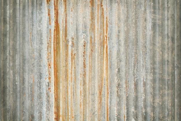 Vieux fond de texture de zinc, rouillé sur une surface en métal galvanisé.