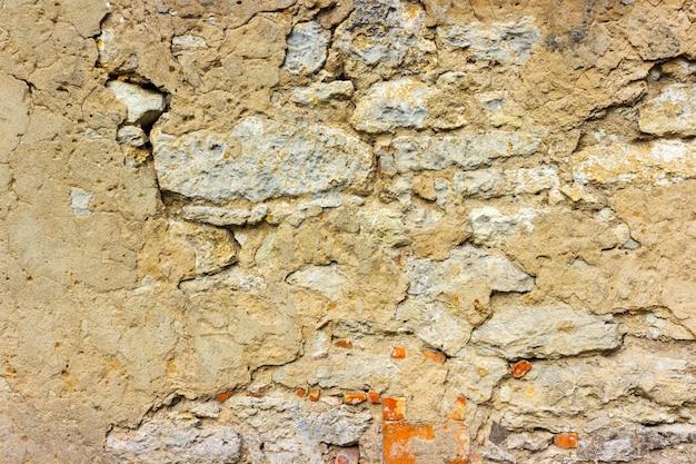Vieux fond urbain de texture de mur de briques de plâtre béton